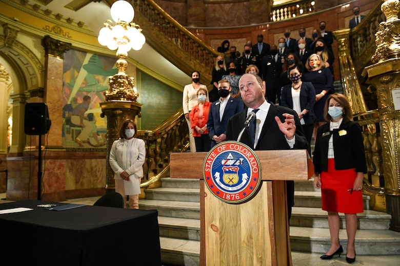 Colorado Gov. Jared Polis gives a speech during the signing of Colorado House Bill 20-1326 at the Colorado State Capitol Building in Denver, June 25, 2020.