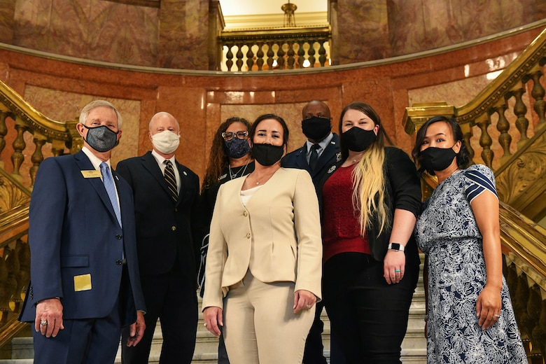 Attendants of the Colorado House Bill 20-1326 signing pose for a group photo at the Colorado State Capitol Building in Denver, June 25, 2020.