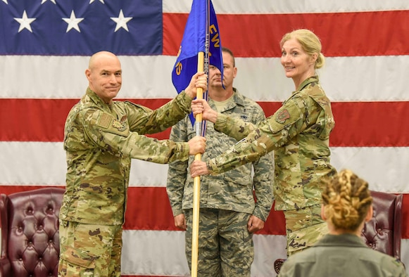 Col. Jim Greenwald, 944th Fighter Wing commander, presented command of the 944th MDS to Col. Jennifer Archer in front of fellow commanders and peers.