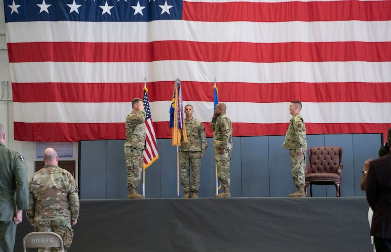 Colonel Peter Bonetti, 90th Missile Wing commander, salutes, Colonel Tytonia Moore, 90th Operations Group incoming commander, as he assumes command of the 90th OG during a change of command ceremony June, 26, 2020, on F.E. Warren Air Force Base, Wyo. A change of command ceremony is a tradition that represents a formal transfer of authority and responsibility from the outgoing commander to the incoming commander. (U.S. Air Force photo by Senior Airman Braydon Williams)