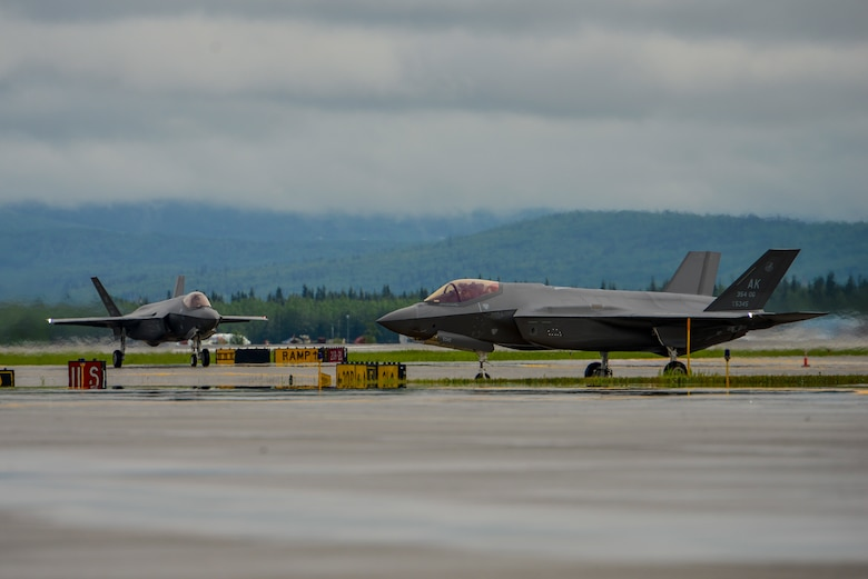 Two U.S. Air Force F-35A Lightning IIs assigned to the 356th Fighter Squadron taxi on the Fairbanks International Airport (FAI) runway at Fairbanks, Alaska, June 24, 2020.