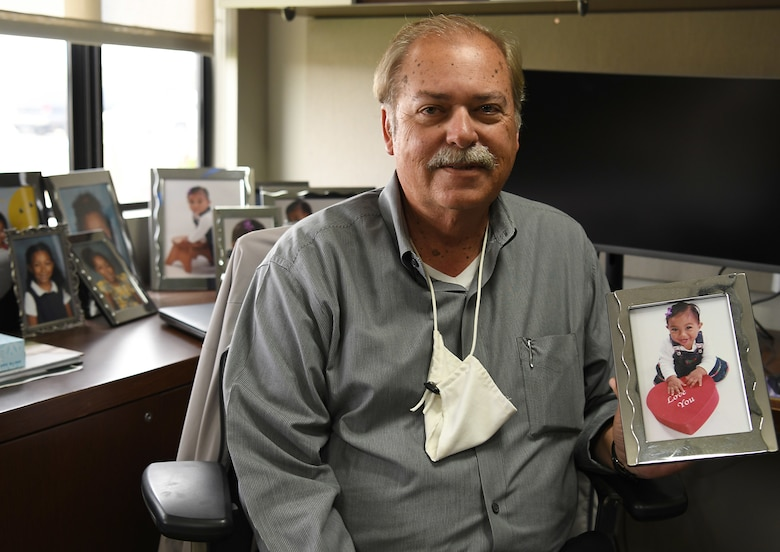 Richard Cote, 30th Civil Engineer Squadron deputy commander, holds a picture of his granddaughter, Jaiden, June 24, 2020, at Vandenberg Air Force Base, Calif.
