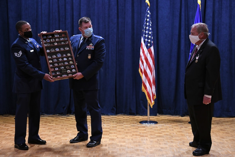 Richard Cote, 30th Civil Engineer Squadron deputy commander, is presented with a gift during his retirement ceremony June 25, 2020, at Vandenberg Air Force Base, Calif.