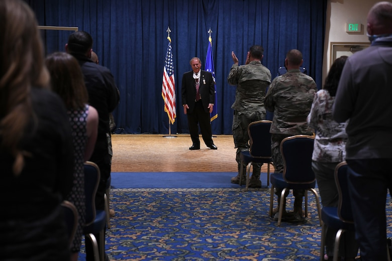The crowd stands and applauds as Richard Cote, 30th Civil Engineer Squadron deputy commander, retires after nearly 40 years of service in the 30th CES June 25, 2020, at Vandenberg Air Force Base, Calif.
