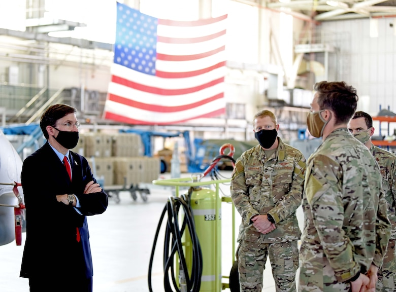 U.S. Secretary of Defense Dr. Mark T. Esper speaks with a 352nd Special Operations Wing air commando during a visit to RAF Mildenhall, England, June 25, 2020. Esper toured the air traffic control tower, static displays of a CV-22 Osprey, RC-135 Rivet Joint and spent time speaking with both officer and enlisted Airmen during his tour. (U.S. Air Force photo by Senior Airman Brandon Esau)