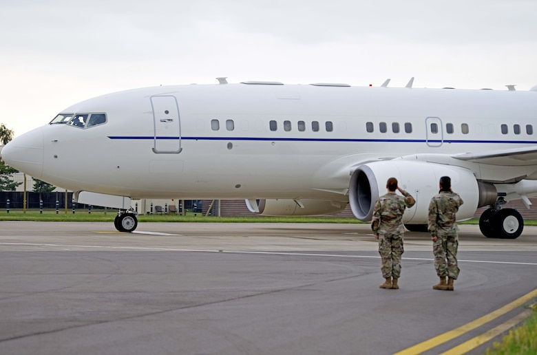 Chief Master Sgt. Kathi Glascock, 100th Air Refueling Wing command chief, and Col. S. Troy Pananon, salute as U.S. Secretary of Defense Dr. Mark T. Esper's C-40 Clipper departs from RAF Mildenhall, England, June 26, 2020. Esper toured the air traffic control tower, static displays of a CV-22 Osprey, RC-135 Rivet Joint and spent time speaking with both officer and enlisted Airmen during his tour. (U.S. Air Force photo by Senior Airman Brandon Esau)