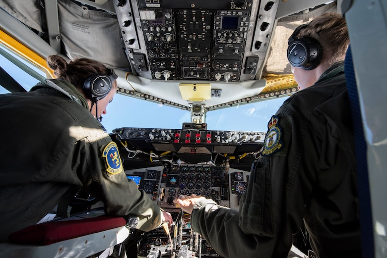 Capt. Marissa Hartoin, 100th Operations Support Squadron chief of wing tactics and instructor pilot, left, and 1st Lt. Elizabeth Avara, 351st Air Refueling Squadron pilot, fly a KC-135 Stratotanker over the North Sea June 18, 2020. The aircrew supported B-2 Spirits from Whiteman Air Force Base, Missouri, by providing aerial refueling during their long range training mission. (U.S. Air Force photo by Airman 1st Class Joseph Barron)