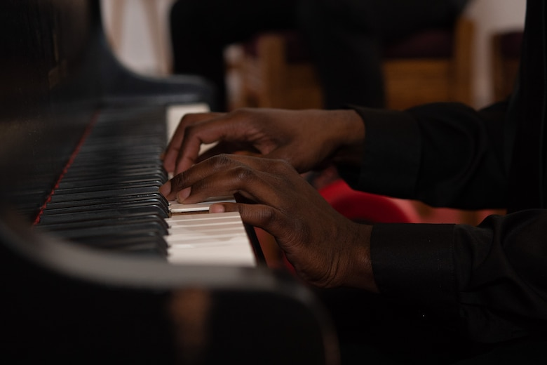 Close up of U.S. Army Spc. Willie Reed, U.S. Army Europe Band and Chorus hands playing the piano during the Juneteenth: Vigil for Healing event at Ramstein Air Base, Germany, June 19, 2020.