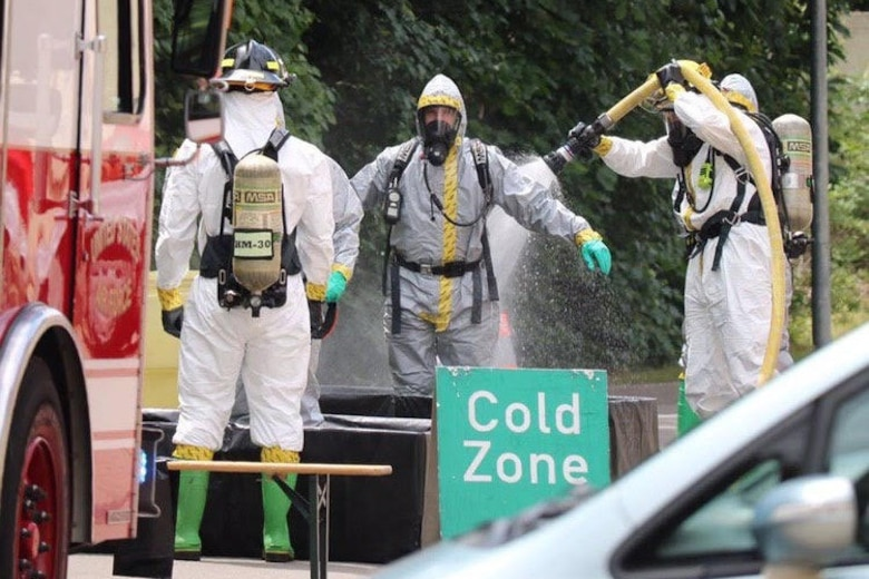 U.S. Air Force Staff Sgt. Erickson Zinger, 786th Civil Engineer Squadron Emergency Management Logistics noncommissioned officer in charge, goes through technical decontamination, provided by the 86th CES Fire Department, as he returns from the incident area to a clean zone.