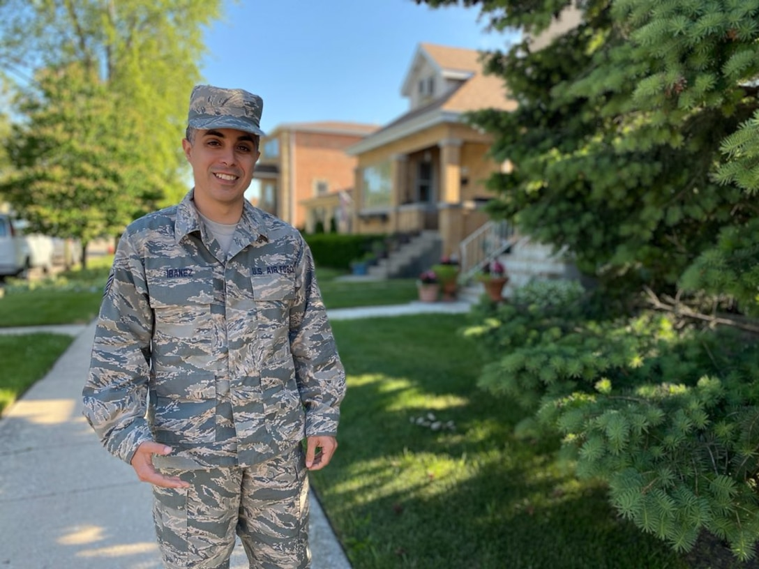 Tech. Sgt. Brandon Ibanez, a cyber intelligence analyst with the 854th Combat Operations Squadron, stands for a photo outside his home in Chicago, Illinois, June 15, 2020. Ibanez's role in his unit requires him to analyze intelligence and triangulate technical, geographical and operational information to provide situational awareness for leadership. (Courtesy photo by Anna Czekaj)