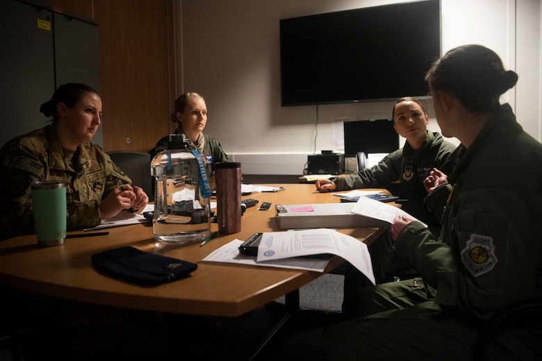 Aircrew members from the 351st Air Refueling Squadron conduct a mission briefing before supporting a strategic bomber mission at RAF Mildenhall, England, June 18, 2020. Four KC-135 Stratotankers provided in-air refueling for B-2 Spirit stealth bombers from the 509th Bomb Wing at Whiteman Air Force Base, Missouri. (U.S. Air Force photo by Airman 1st Class Joseph Barron)