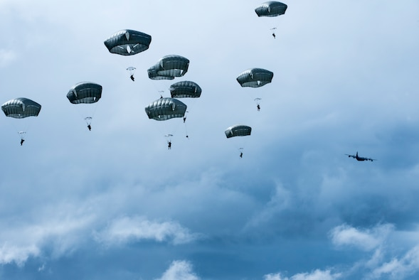 Battlefield Airmen assigned to the 3rd Air Support Operations Squadron descend after jumping from a HC-130J Combat King ll during airborne training over Malemute Drop Zone at Joint Base Elmendorf-Richardson, Alaska, June 24, 2020. The 3rd ASOS conducted the airborne training to maintain operational readiness. (U.S. Air Force photo by Senior Airman Jonathan Valdes Montijo)