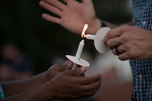 People light each other's candle