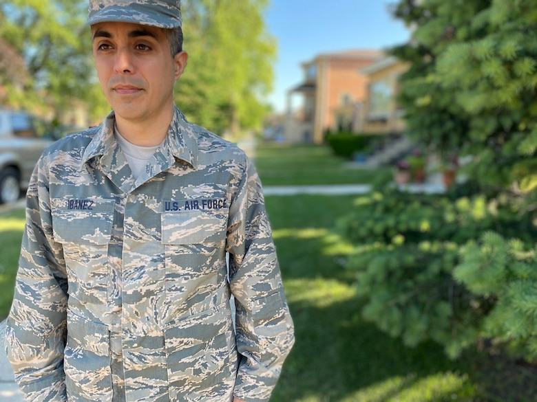 Tech. Sgt. Brandon Ibanez, a cyber intelligence analyst with the 854th Combat Operations Squadron, stands in uniform for a photo outside his home in Chicago, Illinois, June 15, 2020. As a Gladiator in the 960th Cyberspace Wing, it's not a requirement to don the traditional uniform of ancient Roman fighters, and it would be impractical because the enemy in cyberspace doesn't attack using guns or spears. (Courtesy photo by Anna Czekaj)