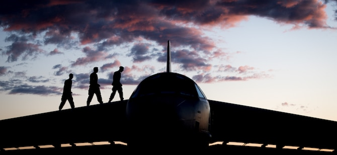Staff Sgt. Jacob Lieuallen, Senior Airman Tommy Chase and Airman 1st Class Nathan Fanny, 96th Aircraft Maintenance Unit crew chiefs, pose for a photo on top of a B-52H Stratofortress at Eielson Air Force Base, Alaska, June 17, 2020. Bomber Task Force missions enable crews to maintain a high state of readiness and proficiency and validate the always-ready global strike capability. (U.S. Air Force photo by Senior Airman Lillian Miller)
