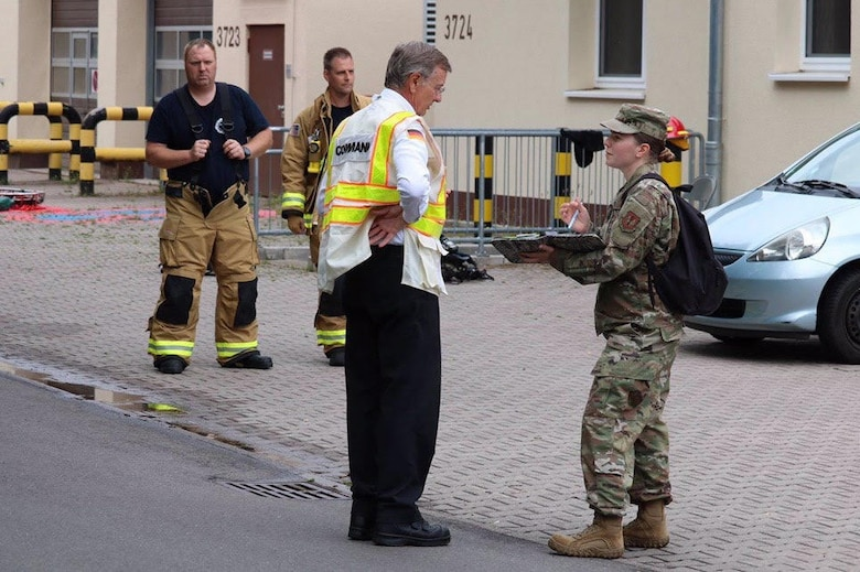 U.S. Air Force Master Sgt. Jessica Clayton, 786th Civil Engineer Squadron Emergency Management Operations noncommissioned officer in charge, briefs response options to the incident commander at Landstuhl Regional Medical Center, Germany, June 16, 2020.