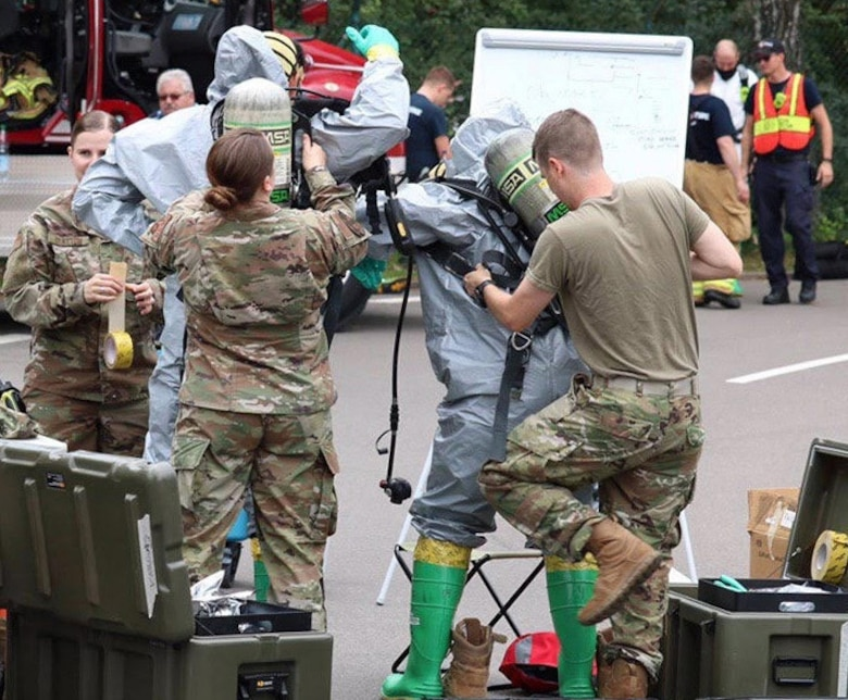 U.S. Air Force Airmen, assigned to the 786th Civil Engineer Squadron Emergency Management flight assist fellow Airmen on response Team 1 don personal protective equipment in Level B suits so they can safely make entry into a potentially contaminated area at Landstuhl Regional Medical Center, Germany, June 16, 2020.