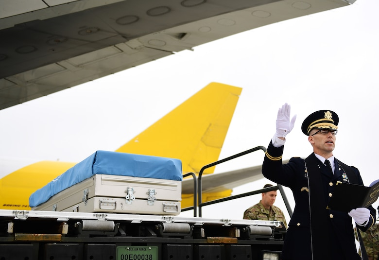 A chaplain says a prayer during a repatriation ceremony