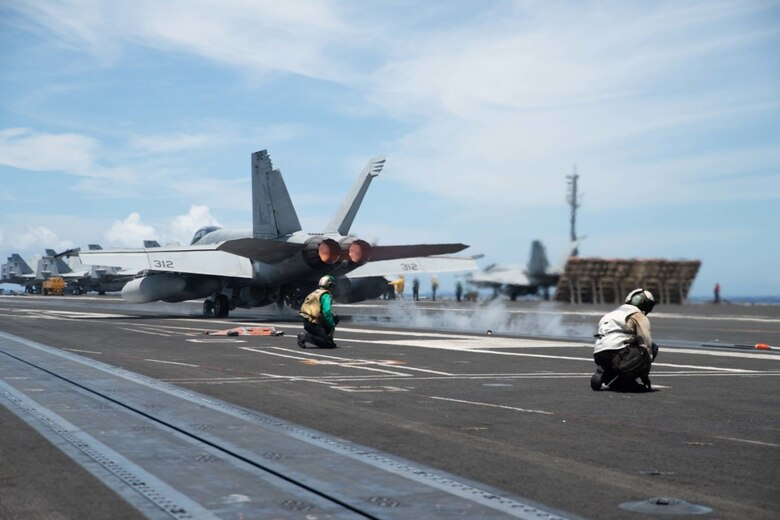 Official U.S. Navy photo of an F/A-18F Super Hornet from the aircraft carrier USS Ronald Reagan (CVN 76)