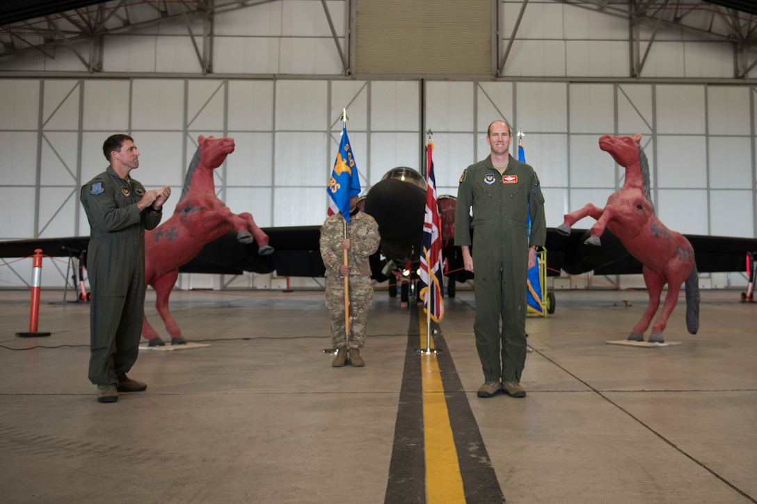 U.S. Air Force Lt. Col. Brian Staniszewski, assumes command of the 99th Expeditionary Reconnaissance Squadron, during a change of command ceremony, at RAF Fairford, England, June 24, 2020. The change of command ceremony is a military tradition that represents a formal transfer of a unit's authority and responsibility from one commander to another. (U.S. Air Force photo by Airman 1st Class Jennifer Zima)