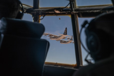 A division of U.S. Marine Corps KC-130Js with Marine Aerial Refueler Transport Squadron (VMGR) 352, assigned to the Special Purpose Marine-Air Ground Task Force - Crisis Response - Central Command 20.2, execute maneuvers during a division flight in Kuwait, June 24, 2020.
