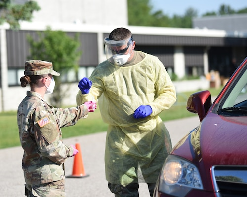 Soldiers from the Michigan Army National Guard conduct free drive-thru COVID-19 testing in Alpena, Michigan, June 19, 2020. The Guard has 20 three-person teams supporting community testing throughout Michigan.