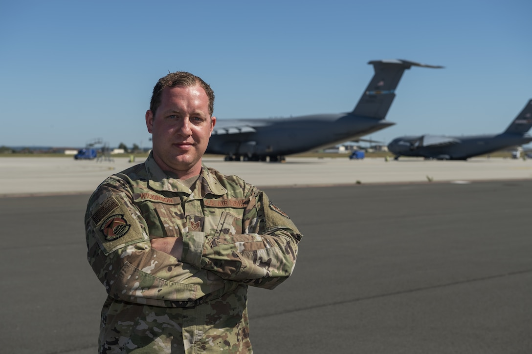 U.S. Air Force Staff Sgt. Michael Wilkinson, 726th Air Mobility Squadron aerospace maintenance craftsman, poses for a photo on the flightline at Spangdahlem Air Base, Germany, June 24, 2020. Wilkinson is credited with saving the life of an impaired trucker who had gone off the road on the German Autobahn. (U.S. Air Force photo by Senior Airman Branden Rae)