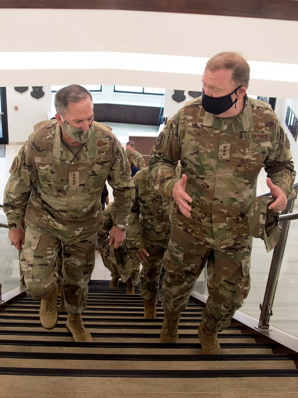 Photo of Air Force Chief of Staff Gen. David L. Goldfein, left, and Chief of Air Force Reserve Lt. Gen. Richard W. Scobee, walking up stairs inside the new headquarters for Air Force Reserve Command, at Robins Air Force Base, Georgia, June 24, 2020.