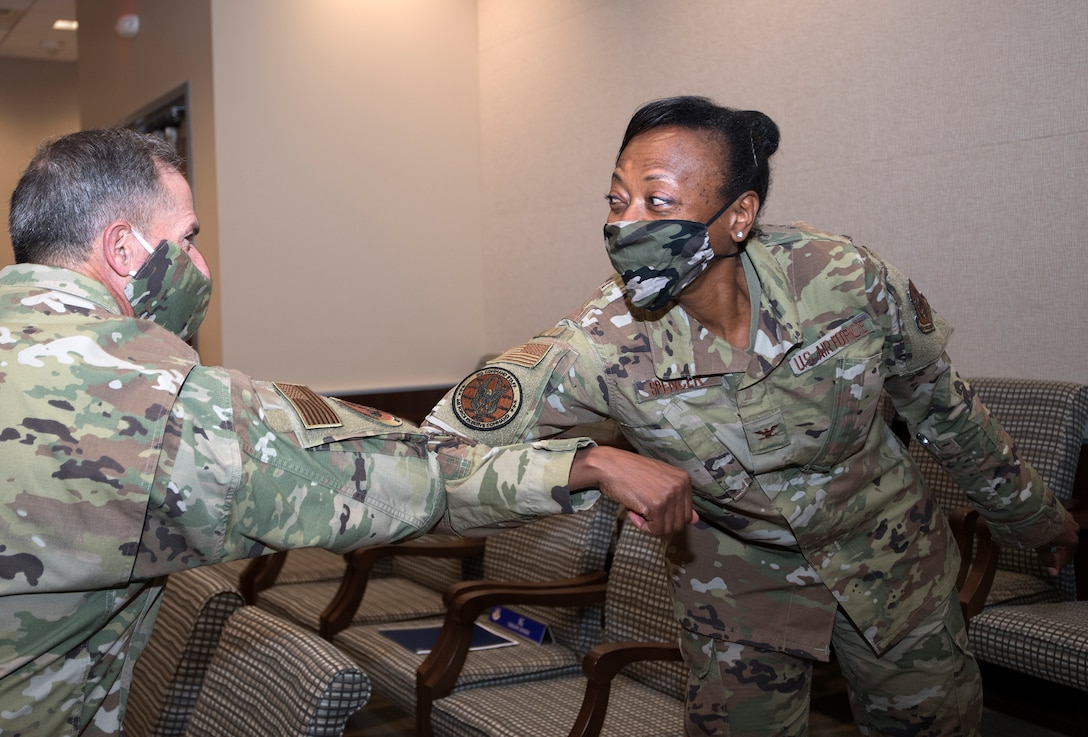 Photo of Air Force Chief of Staff Gen. David L. Goldfein, elbow bumping Col. Eltressa Spencer, Commanders Action Group Director for Air Force Reserve Command, as a greeting and a safety measure against COVID-19, at Robins Air Force Base, Georgia, June 24, 2020.