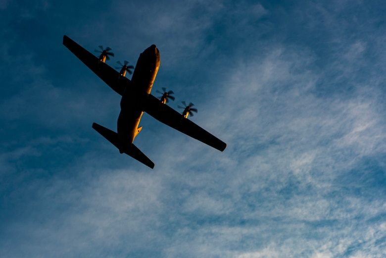 A C-130J Super Hercules flies over the flightline at Dyess Air Force Base, Texas, June 3, 2020. The 317th Airlift Wing recently finished the first round of the new 4/12 C-130 deployment cycle. The 4/12 deployment cycle allows an entire C-130J airlift squadron and their associated maintenance unit to deploy for four months, which allows Airmen a 12 month dwell time at home station before the next scheduled deployment. (U.S. Air Force photo by Airman 1st Class Colin Hollowell)