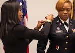 Sherry Gaither, a pastor at Stronghold Christian Church in Lithonia, Georgia, promotes Georgia Army National Guardsman Chief Warrant Officer 3 Joselyn N. White, human resources officer, Joint Force Headquarters-Georgia during a promotion ceremony in February 2019 at the Clay National Guard Center, Marietta, Georgia. Army leaders announced Thursday that photos will be removed from all promotion boards beginning in August.