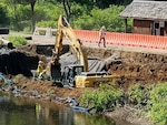 Heavy construction machinery continues repairs along the access road to a dam in Tionesta, Pennsylvania June 25, 2020.