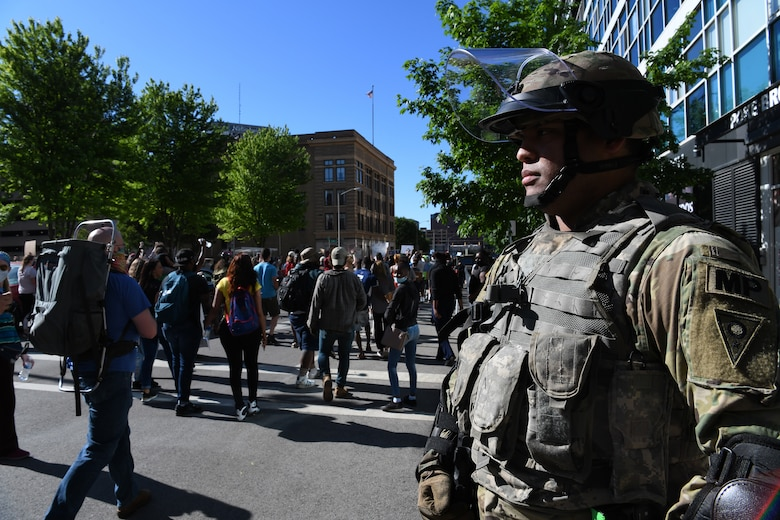 Cpl. James Target, an Ohio Army National Guard military police team leader, stands guard during ongoing protests May 31, 2020, in downtown Columbus, Ohio. Gov. Mike DeWine activated the Ohio National Guard to assist local law enforcement in Columbus and Cleveland with providing safety and protection to the community, while ensuring people's right to gather and demonstrate peacefully.
