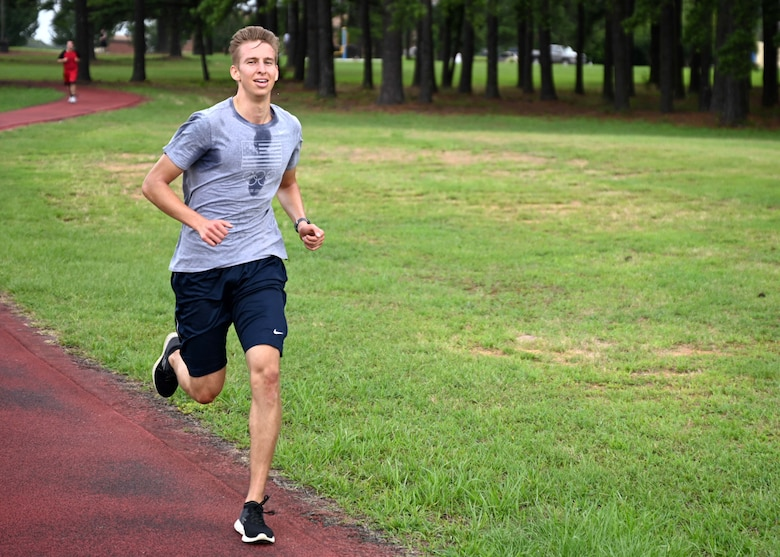 Senior Airman Trenton Sikute, 19th Contracting Squadron contract specialist, runs on the track during a Vital 90 course as part of Wingman Day at Little Rock Air Force Base.