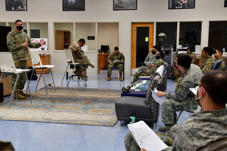 Senior Master Sgt. Brock Atchley, 19th Force Support Squadron career assistance advisor, teaches a class on professional development during Wingman Day at Little Rock Air Force Base.