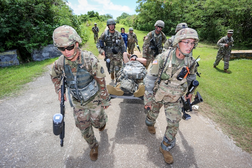 Officer candidates carry a patient on a litter during a training exercise.