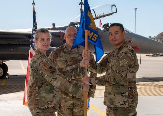 Col. Leah R. Fry, 4th Maintenance Group commander (left), passes the guidon to Maj. Ryan B. Hudson (right), as Hudson assumes command of the 4th Equipment Maintenance Squadron during a change of command ceremony at Seymour Johnson Air Force Base, North Carolina, June 26, 2020.