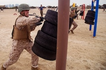 A recruit with Mike Company, 3rd Recruit Training Battalion participates in the Bayonet Assault course at Marine Corps Recruit Depot, San Diego, June 24, 2020.