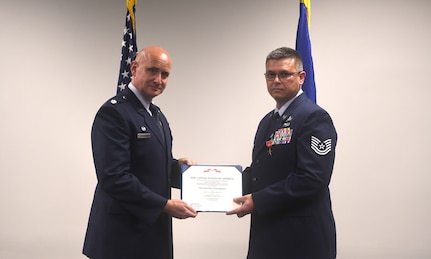 U.S. Air Force Lt. Col. John Barrett, 628th Logistics Readiness Squadron commander presents Tech. Sgt. David Hoy, 628th LRS Fuels Control Center NCO in charge, a Bronze Star Medal award for his excellence during a deployment to Afghanistan, June 18, 2020 at Joint Base Charleston, S.C. During his deployment, Hoy traveled to various Afghan bases where he would advise on processes involving jet fuels transport and storage. He was rewarded with the Bronze Star Medal as a result of his commitment to the mission.