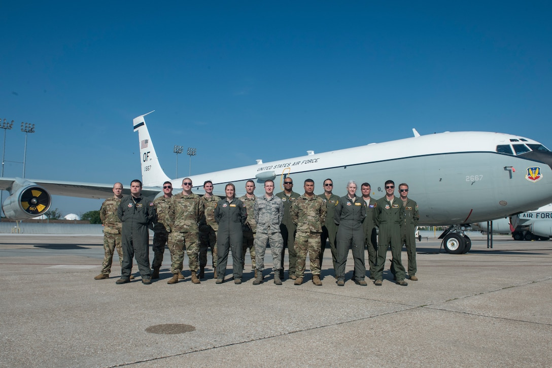 The award winning glass titan team poses for a photo in front of a WC-135W Constant Phoenix on the flightline June 16.