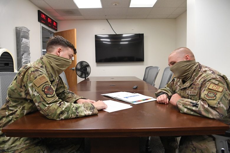 Staff Sgt. Jason Jones, left, 321st Contingency Response Squadron unit deployment manager and Tech. Sgt. Joseph Tanghare, right, 621st Contingency Response Support Squadron UDM, review readiness reports June 29, 2020 at Joint Base McGuire-Dix-Lakhurst, N.J. The 621st Contingency Response Group Readiness Reporting Program assesses a unit's ability to execute it's mission and equip forces for combatant commands. (U.S. Air Force photo by Tech. Sgt. Luther Mitchell Jr)