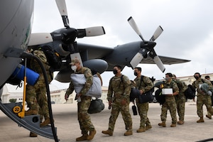 433rd Civil Engineer Squadron firefighters board a C-130H Hercules cargo aircraft June 28, 2020 at Joint Base San Antonio-Lackland, Texas.