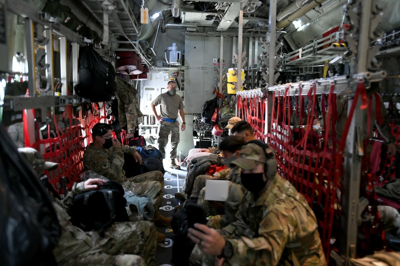 433rd Civil Engineer Squadron firefighters get settled aboard a C-130H Hercules cargo aircraft June 28, 2020 at Joint Base San Antonio-Lackland, Texas.