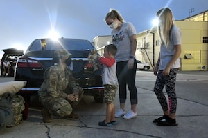 Maj. Leigh Barker, 433rd Civil Engineer Squadron commander, talks to Kason Weertman, son of Master Sgt. Andrew Weertman, 433rd CES assistant chief of operations, while his mother, Ali, and sibling, Abby, stand nearby June 28, 2020, at Joint Base San Antonio-Lackland, Texas.