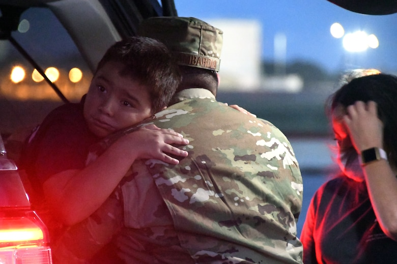 Tech. Sgt. Charles Lambardia, 433rd Civil Engineer Squadron firefighter, hugs his son, Liam, as he prepares to leave for a deployment June 28, 2020, at Joint Base San Antonio-Lackland, Texas.