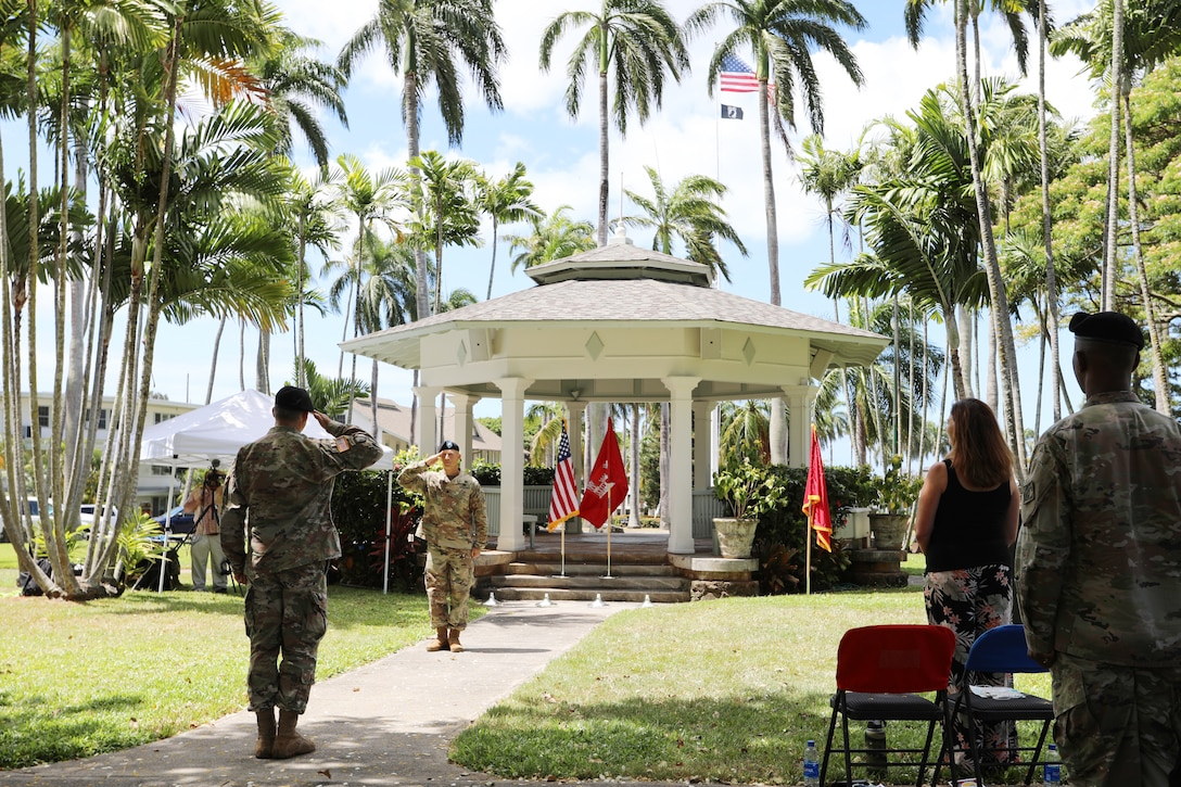 The U.S. Army Corps of Engineers Honolulu District welcomed new leadership today as Lt. Col. Eric S. Marshall (right) assumed command from Lt. Col. Kathryn P. Sanborn (center left) during a modified change of command ceremony at Fort Shafter's Palm Circle Gazebo.