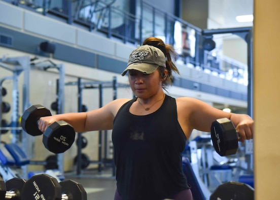 U.S. Air Force Staff Sgt. Samantha Acevedo, 92nd Force Support Squadron fitness assessment cell manager, does a workout in the Fairchild Air Force Base fitness center, June 29, 2020. Physical fitness is important for all Airmen, especially with upcoming physical fitness tests. (U.S. Air Force photo by Airman 1st Class Kiaundra Miller)