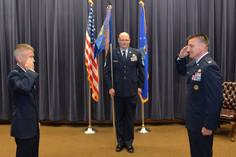 Col. Michael Marsicek, (right), assumes command of the 2nd Weather Group from Col. Brian Pukall (left), 557th Weather Wing commander, during a change of command ceremony at the 557th WW headquarters building, Offutt Air Force Base, Nebraska, June 24, 2020.