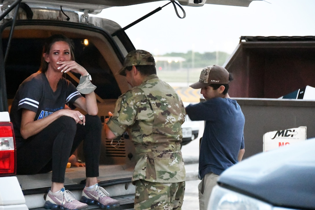 Tech. Sgt. Brian Ynclan, 433rd Civil Engineer Squadron firefighter, spends a few moments with his family before leaving for a deployment June 28, 2020, at Joint Base San Antonio-Lackland, Texas.