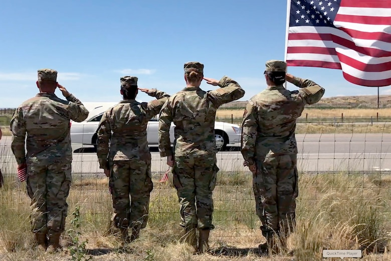 "Reservists from the 419th Fighter Wing salute during a procession for 1st Lt. Kenneth ""Kage"" Allen, a fellow Utahn and Air Force pilot killed in an F-15 crash earlier this month."